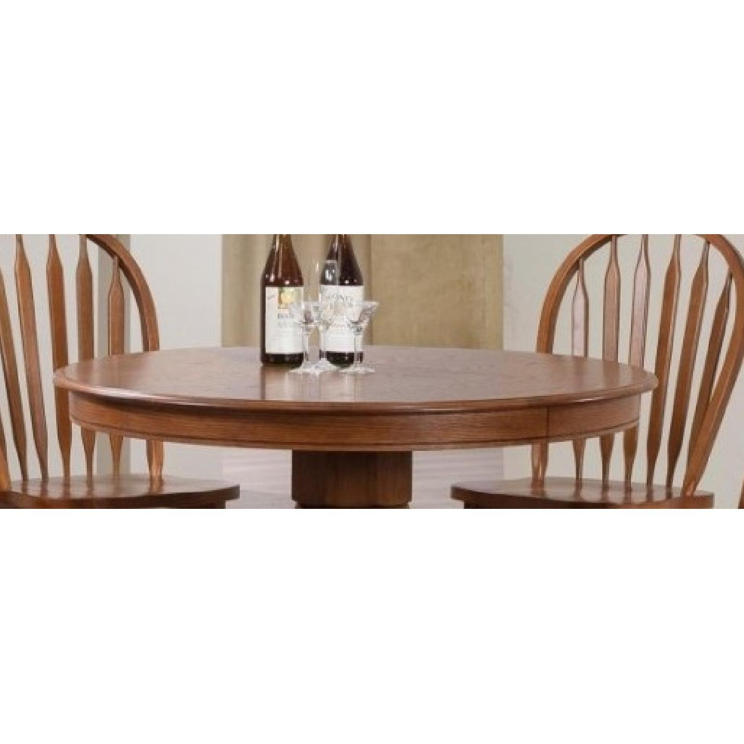 Country Style Round Pedestal Dining Table in Warm Oak Finish - image-3