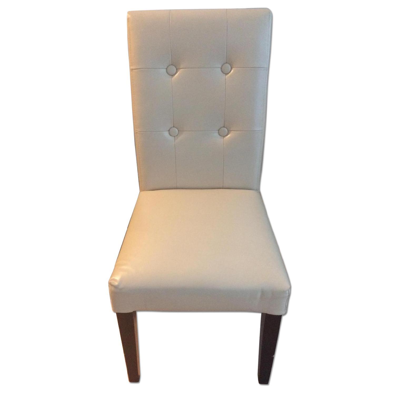 Cream Upholstered Chair w/ Dark Wooden Legs - image-0