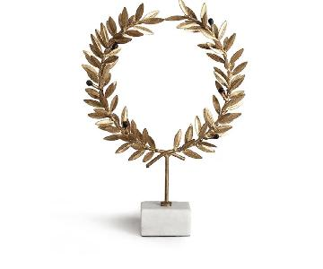 Gold Olive Leaf Wreath On Marble Stand