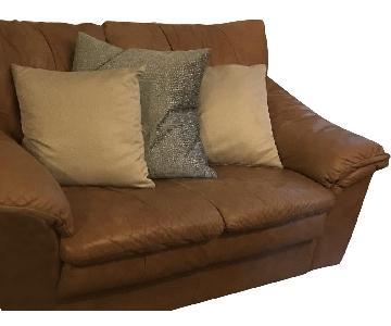 Beige/Tan Leather Loveseatt