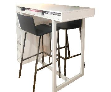 CB2 White High Dining Table w/ 2 Dark Grey Bar Stools