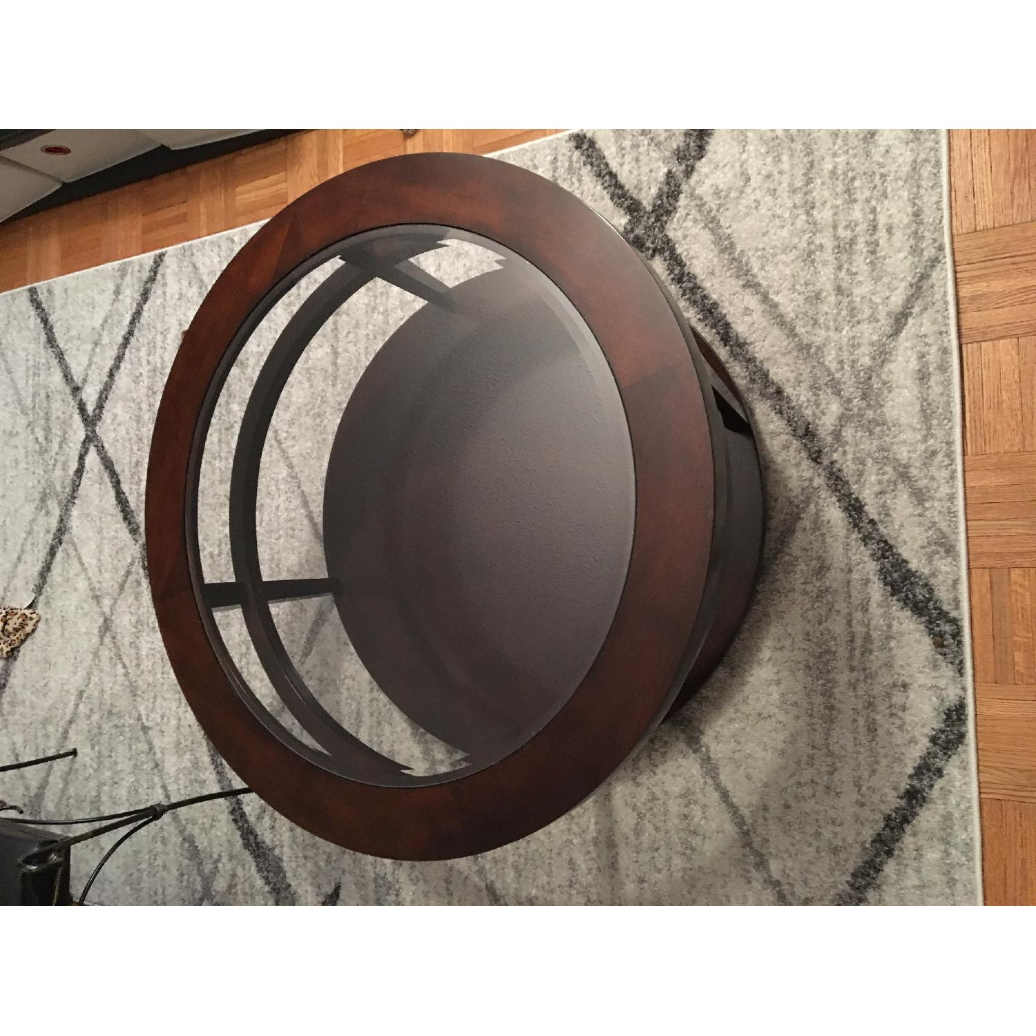 Macy's Round Wood/Glass Coffee Table on Casters - image-2