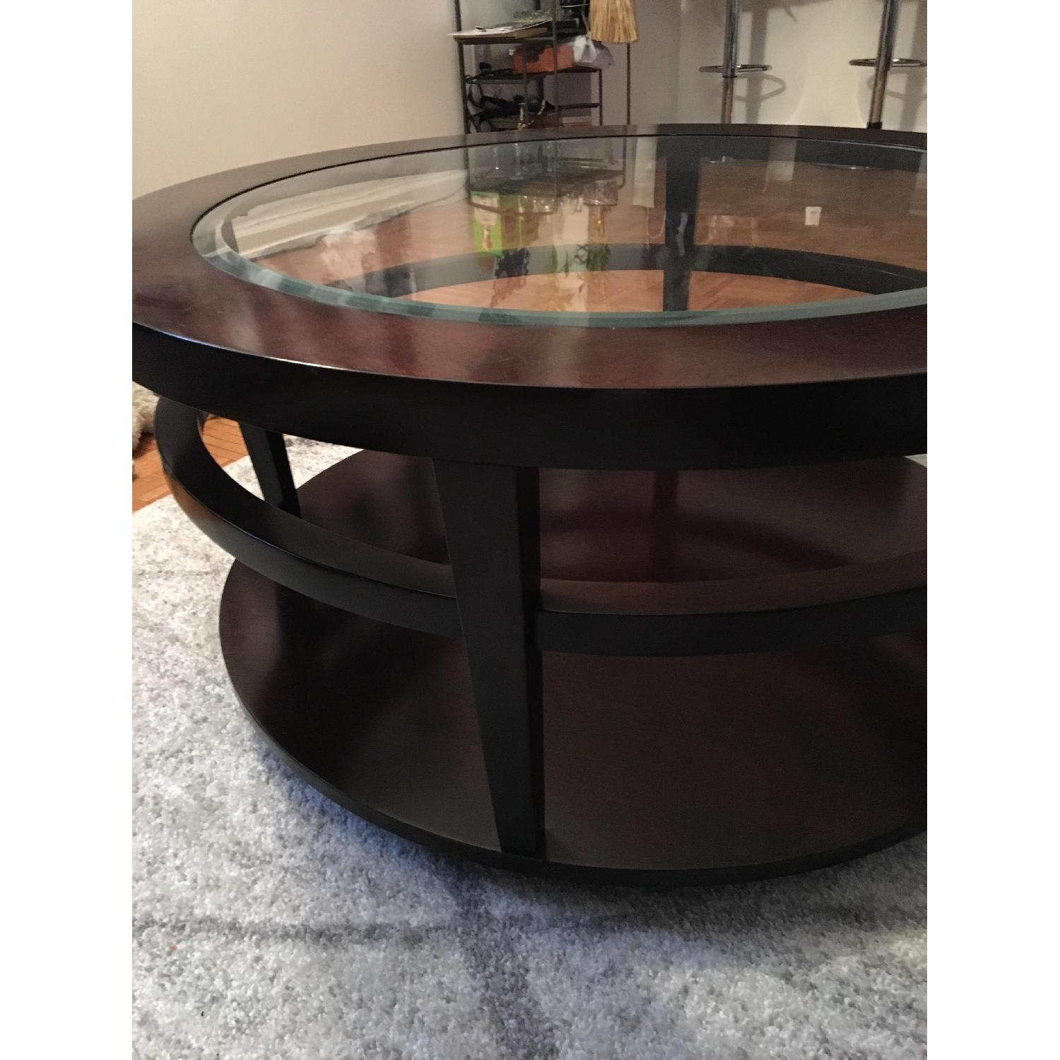 Macy's Round Wood/Glass Coffee Table on Casters - image-3
