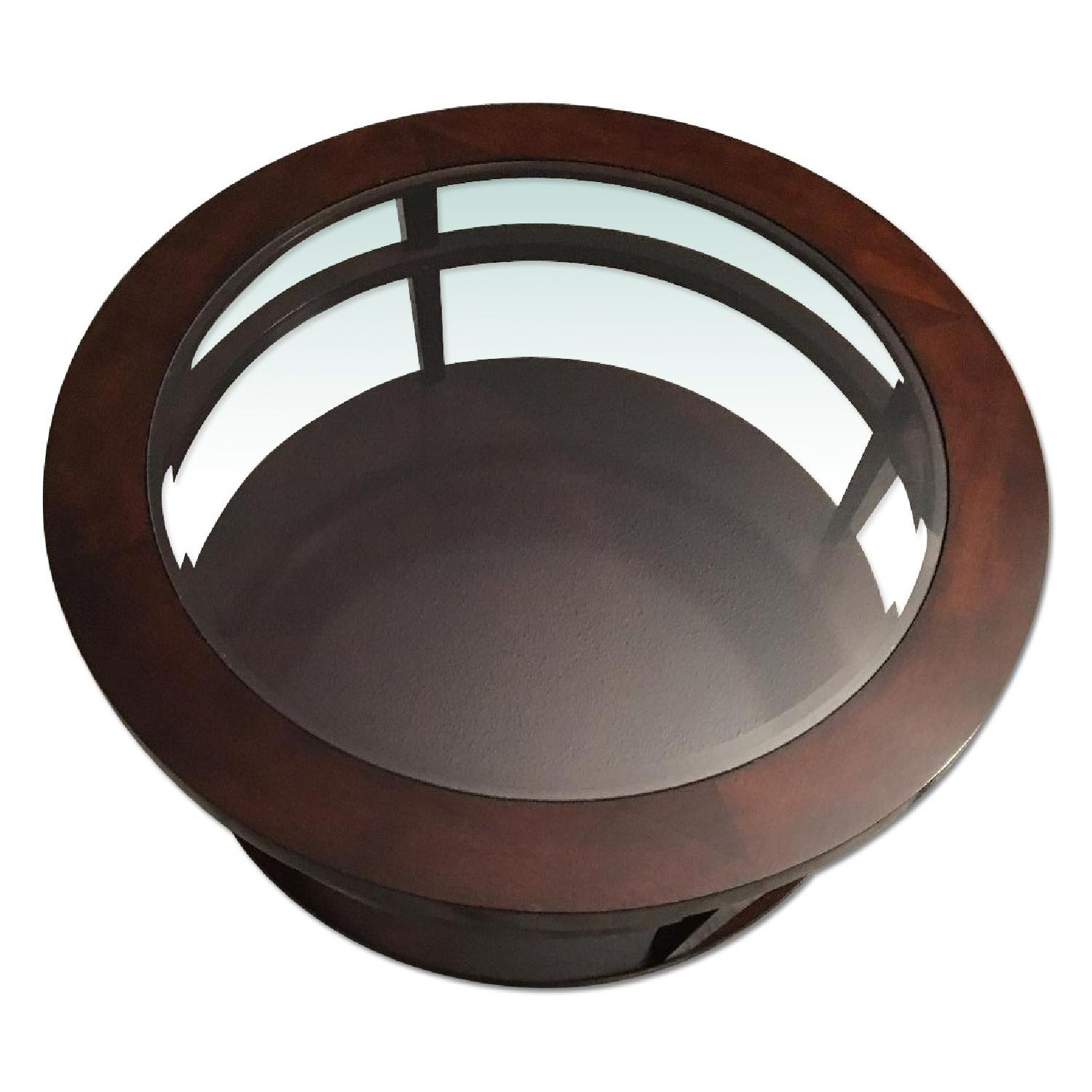 Macy's Round Wood/Glass Coffee Table on Casters - image-4