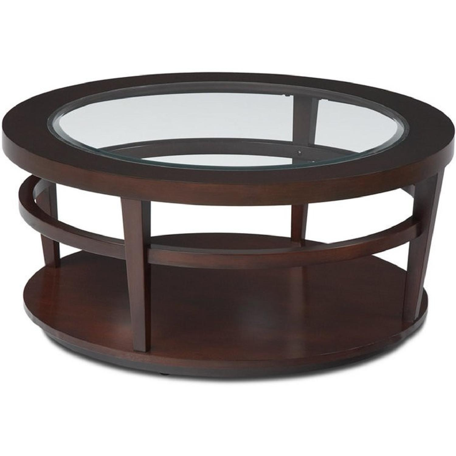 Macy's Round Wood/Glass Coffee Table on Casters - image-0