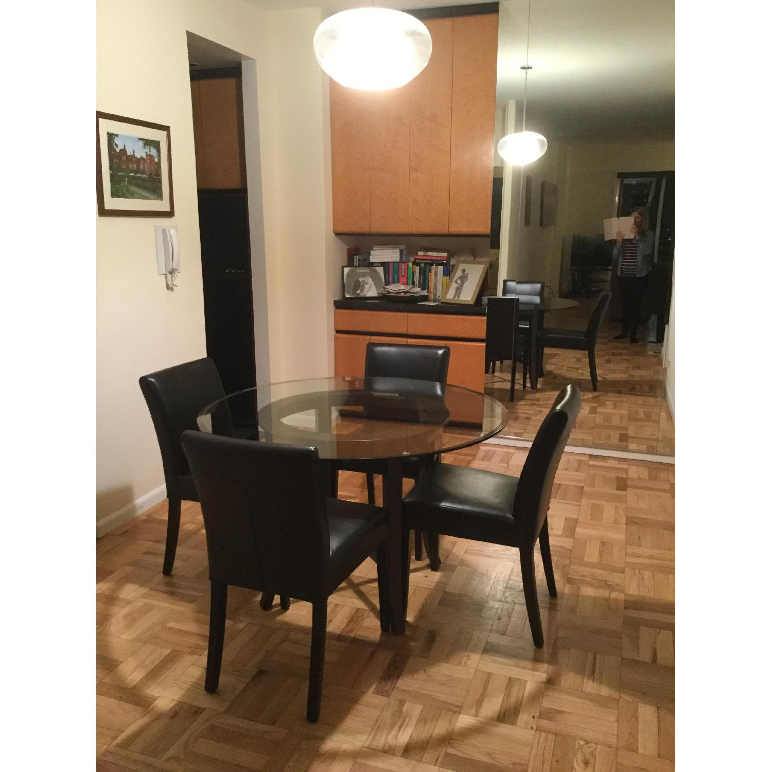 Crate & Barrel Glass Dining Table w/ 4 Black Leather Chairs - image-1
