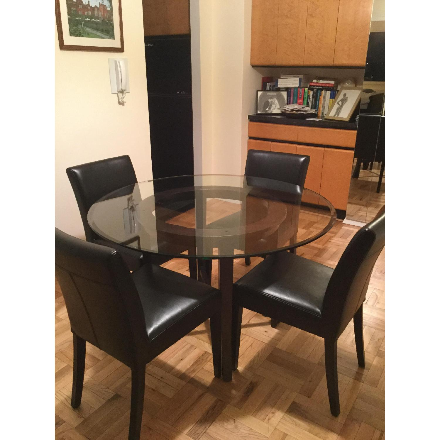 Crate & Barrel Glass Dining Table w/ 4 Black Leather Chairs - image-2