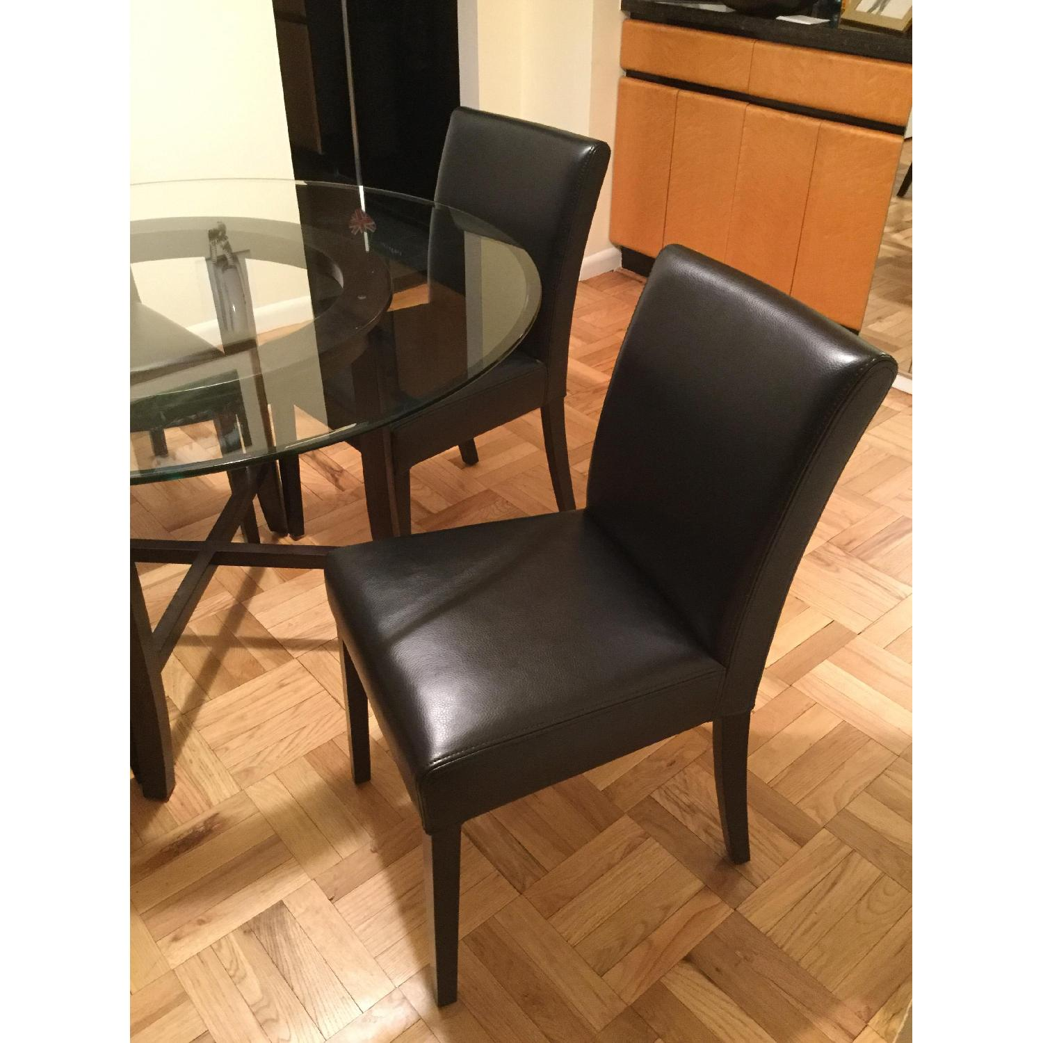 Crate & Barrel Glass Dining Table w/ 4 Black Leather Chairs - image-3