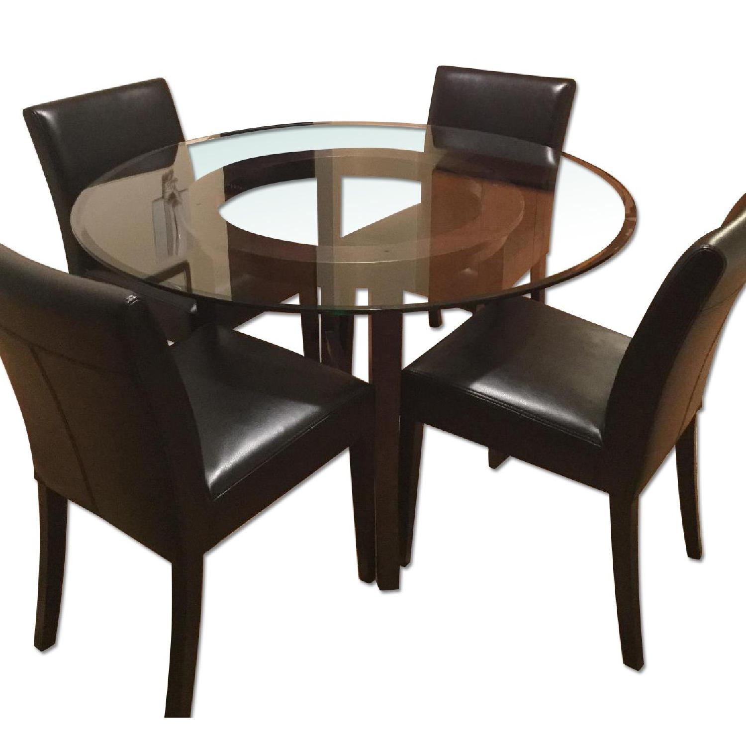 Crate & Barrel Glass Dining Table w/ 4 Black Leather Chairs - image-0
