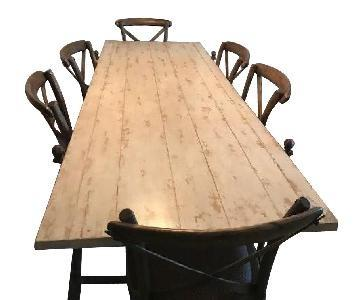ABC Carpet and Home Reclaimed Wood & Iron Dining Table