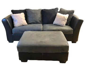 Ashley Dark Gray & Black Leather Sofa & Ottoman