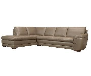Raymour & Flanigan 2 Piece Leather Sectional Sofa & Ottoman