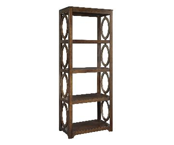 Bookcase Accentuated w/ Circular Design Elements in Chestnut Finish