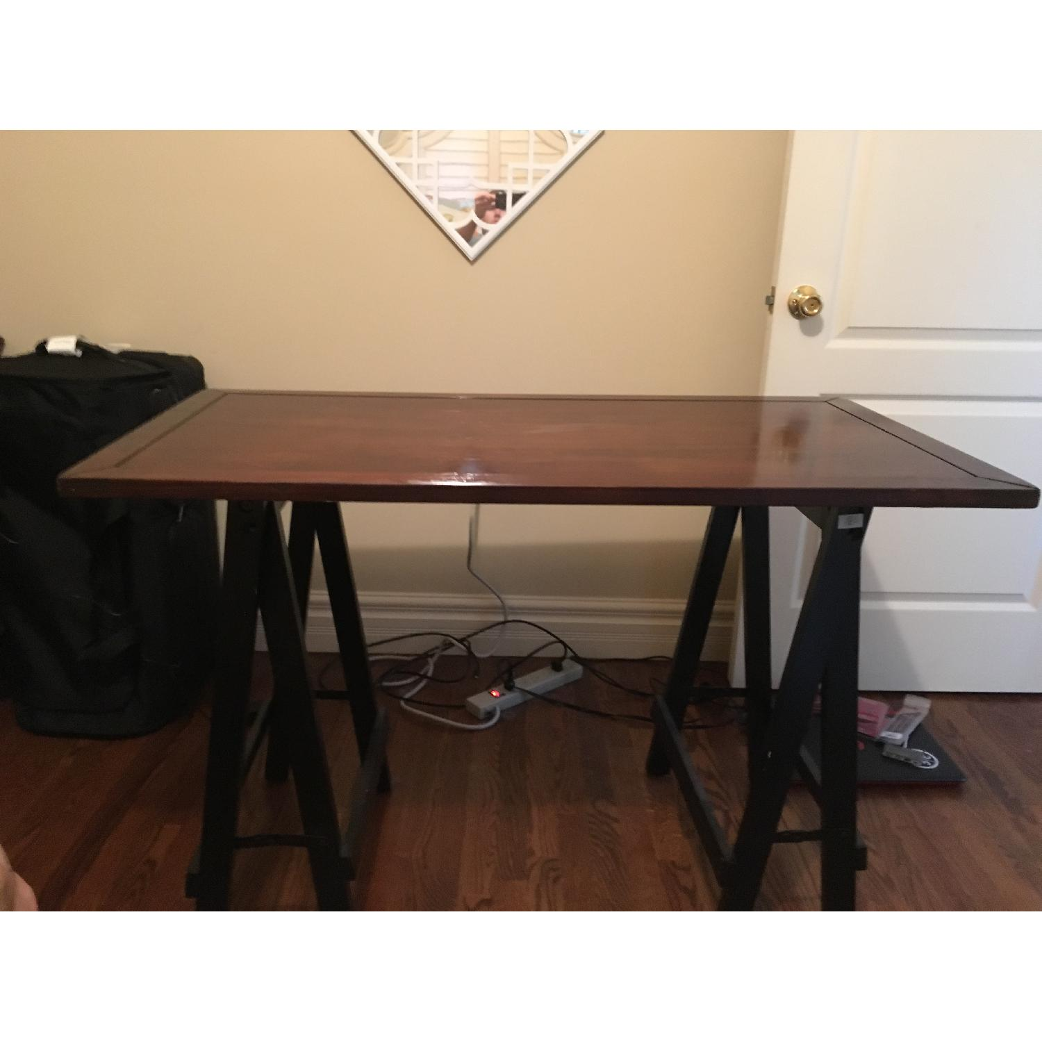 Picture of: Pier 1 Sawhorse Desk Aptdeco
