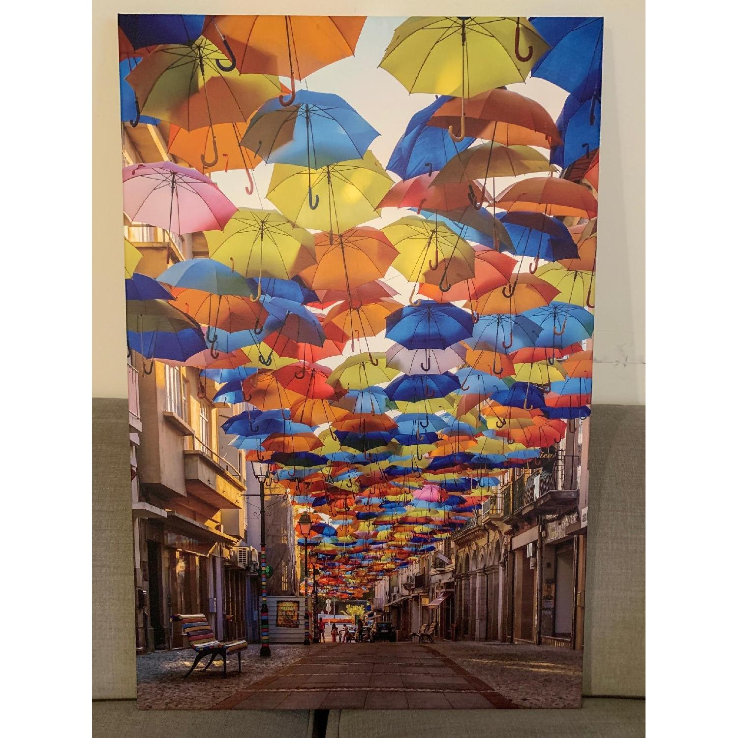 Colorful Floating Umbrellas Canvas Print - image-1