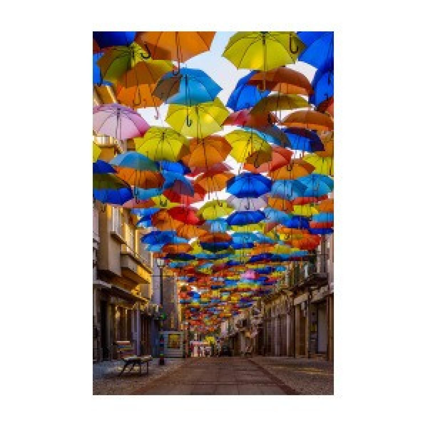 Colorful Floating Umbrellas Canvas Print - image-0