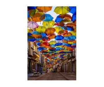 Colorful Floating Umbrellas Canvas Print