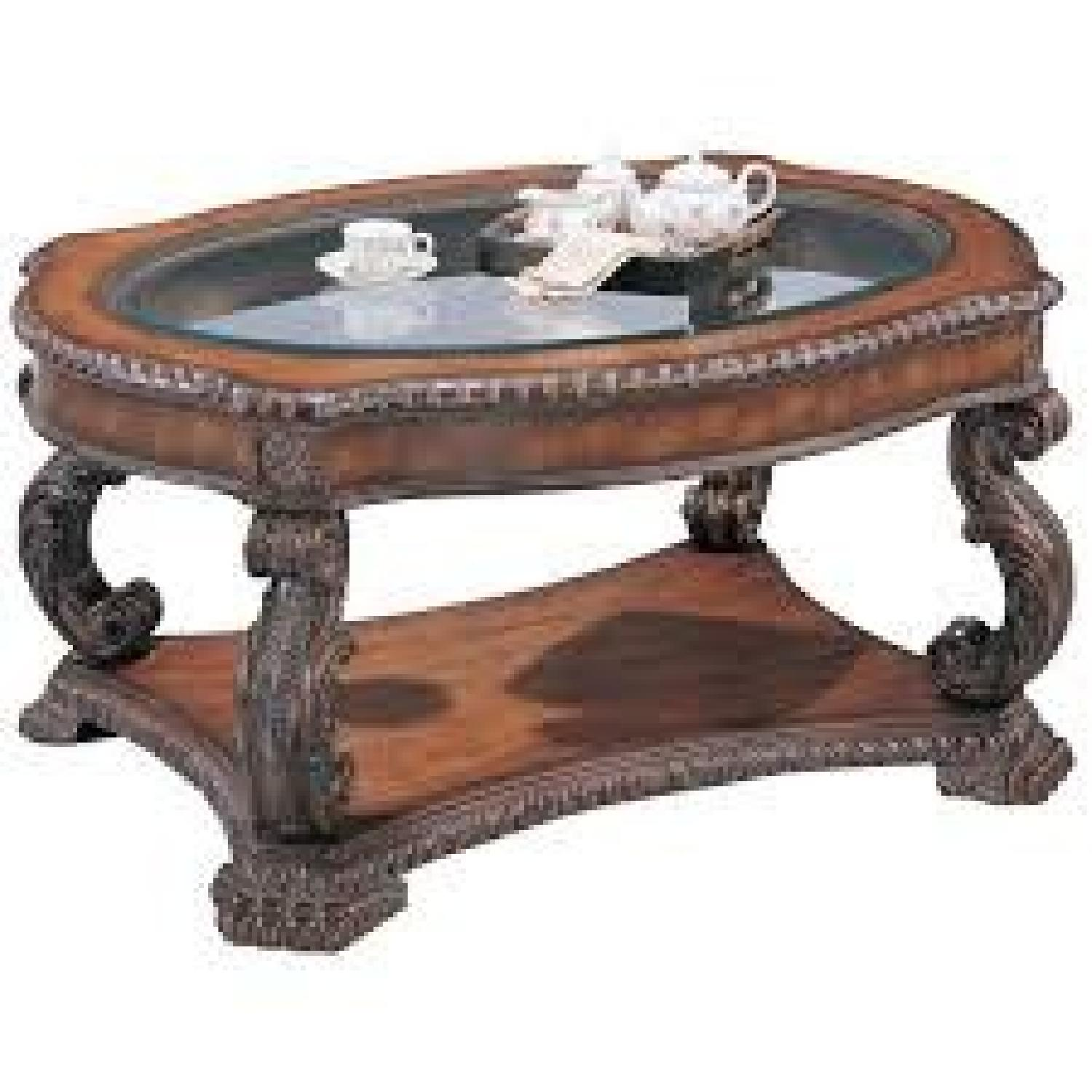 Antique Brown Coffee Table w/ Glass Top - image-0