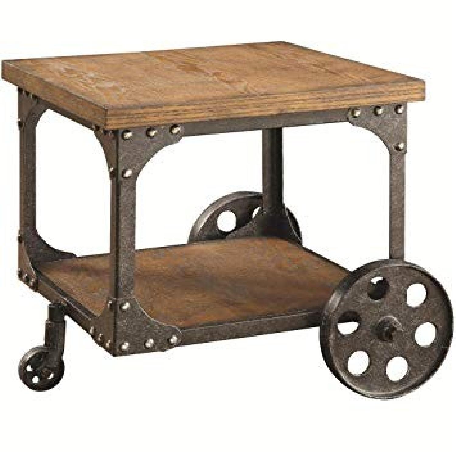 Rustic Brown End Table w/ Metal Wheels - image-0