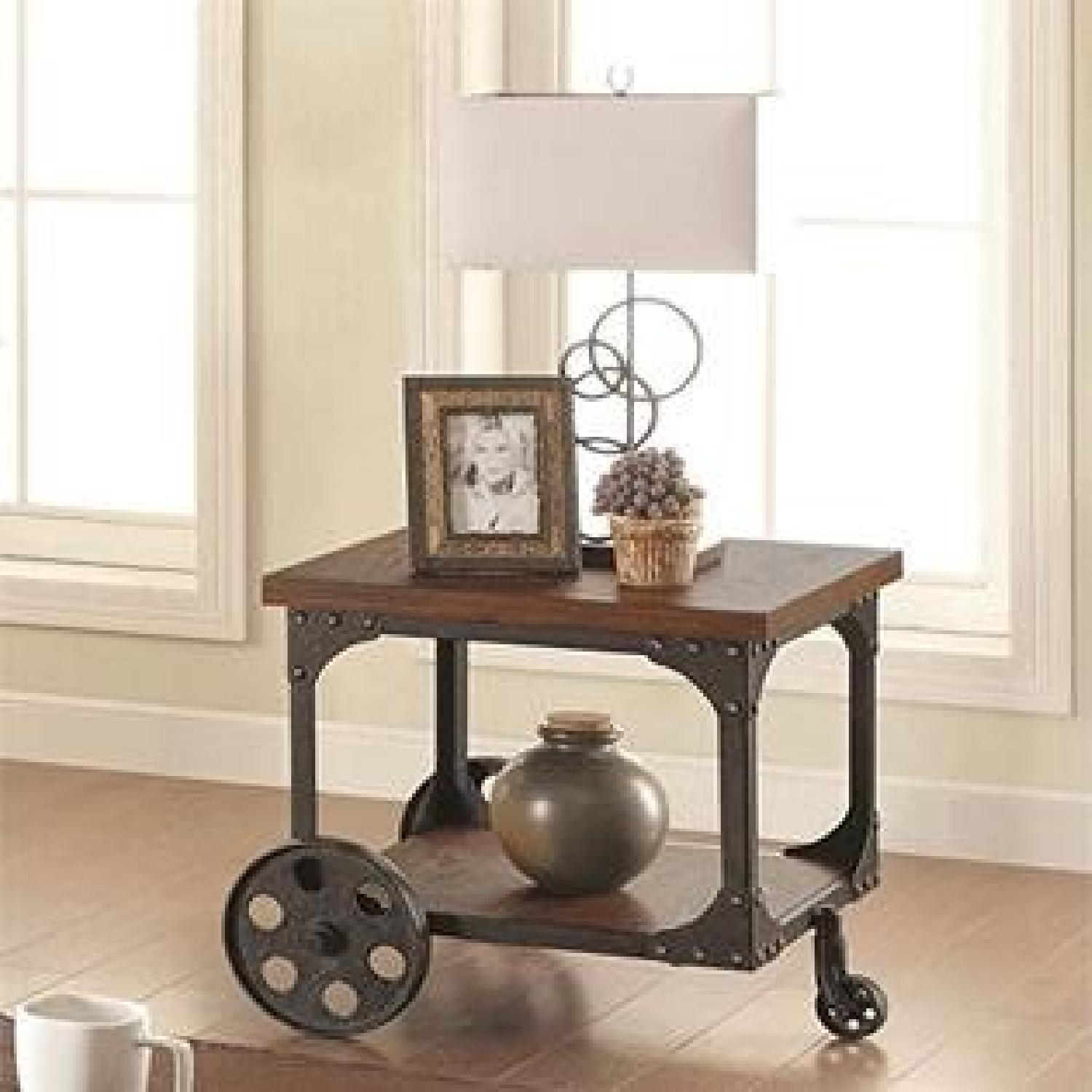 Rustic Brown End Table w/ Metal Wheels - image-1
