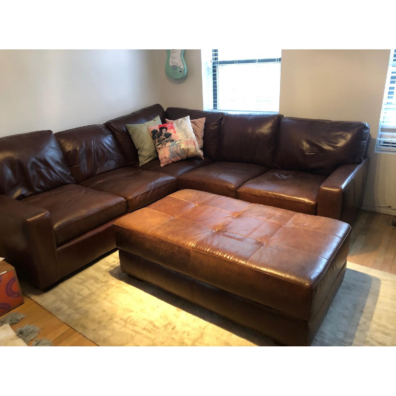 ABC Home Brown Leather Sectional Sofa & Ottoman - AptDeco
