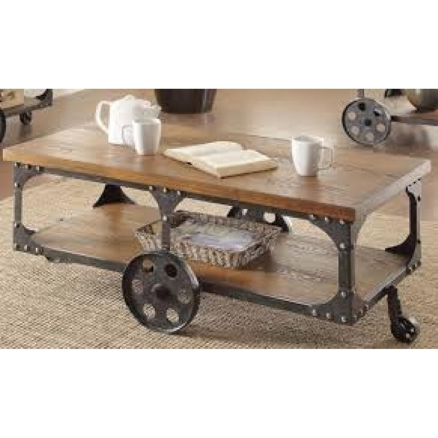 Rustic Brown Coffee Table w/ Metal Wheels - image-1