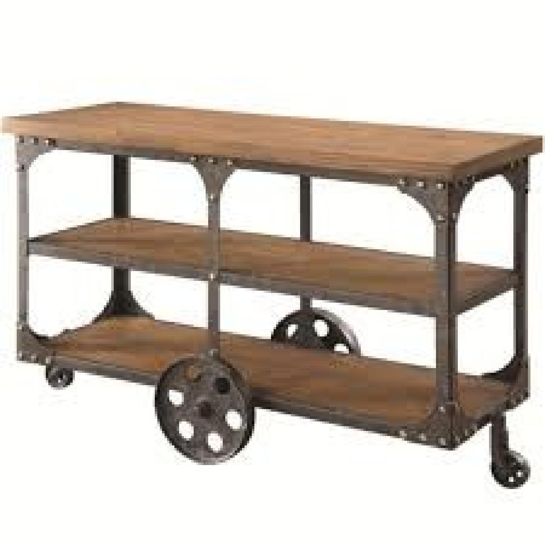 Rustic Brown Sofa Table w/ Metal Wheels - image-0