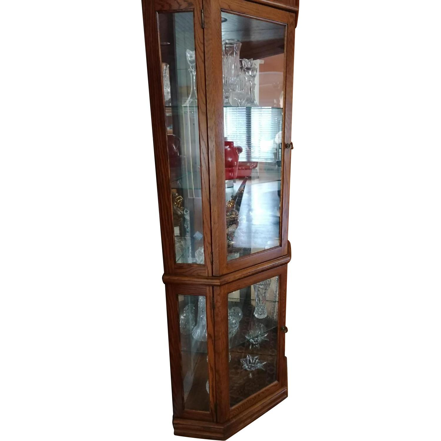Raymour & Flanigan Corner Vitrine Glass & Wood Cabinet