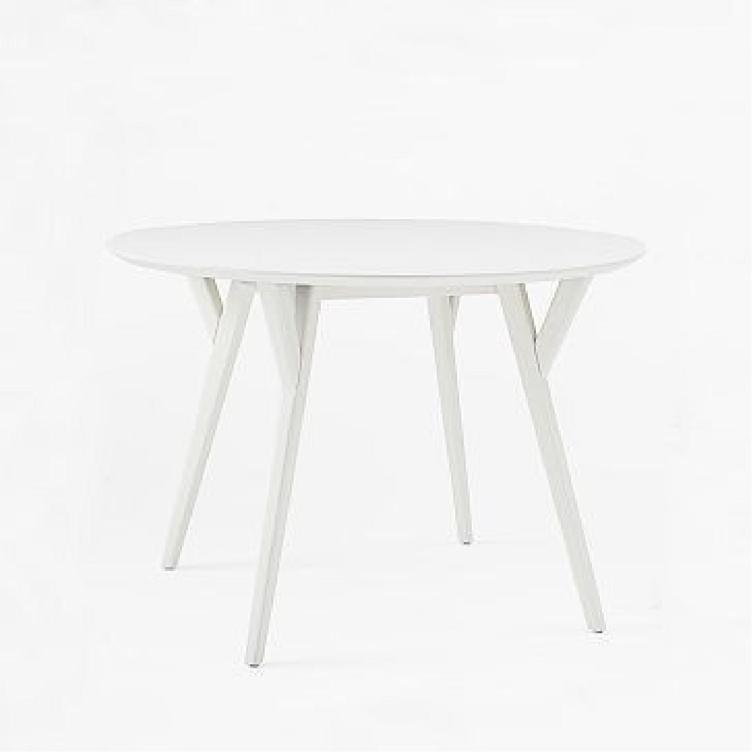 Image of: West Elm Mid Century Round Dining Table Aptdeco