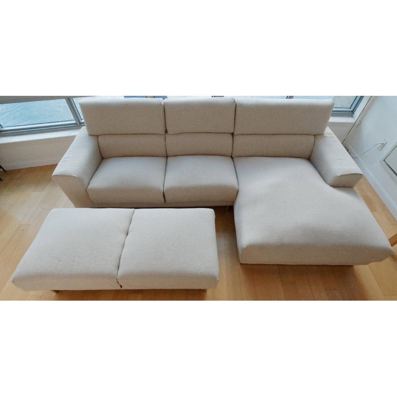 Jennifer Convertibles Chaise Sectional Sofa & Ottoman - AptDeco