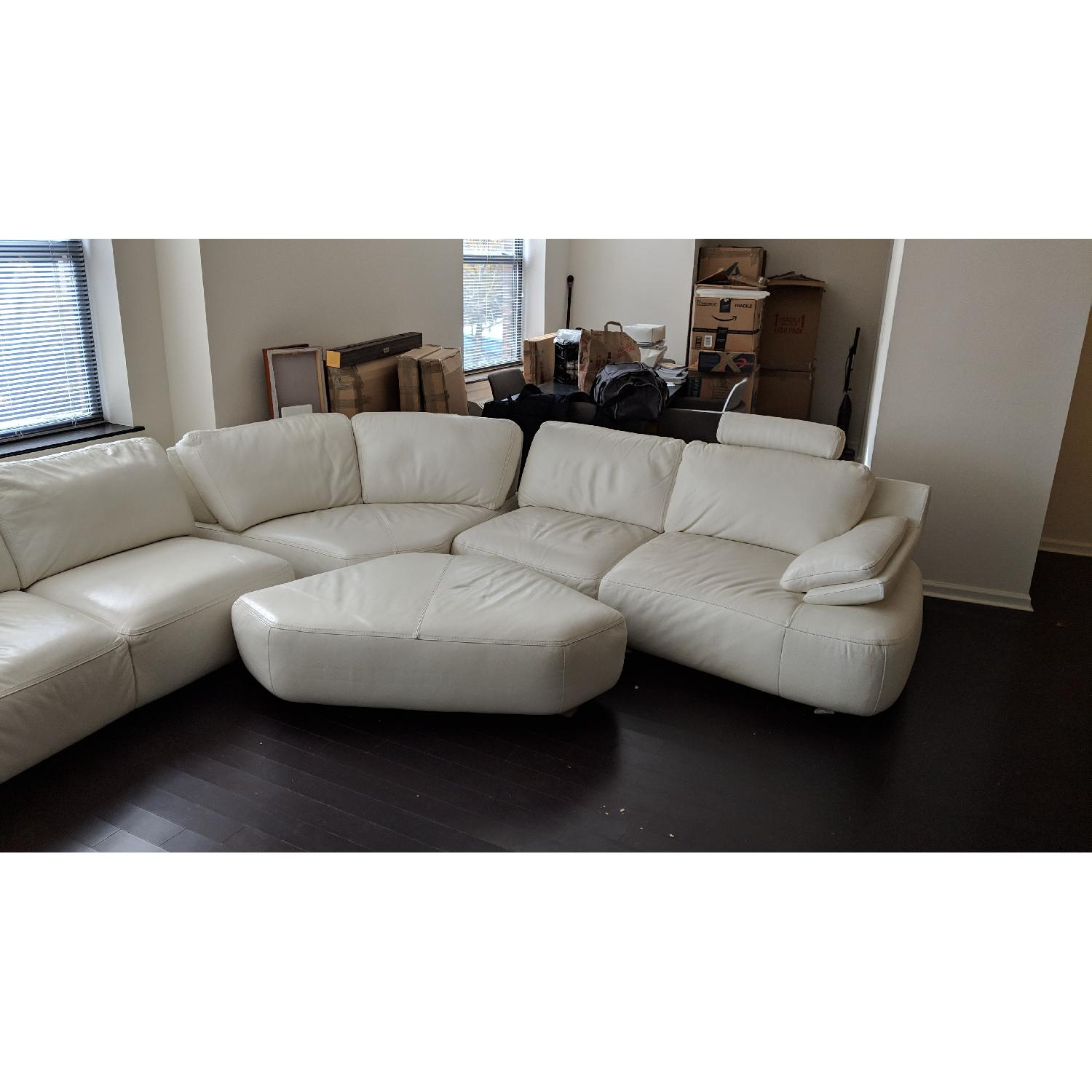 Macy\'s Off White Leather Sectional Sofa & Ottoman - AptDeco