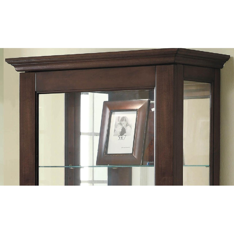 Curio Cabinet In Cappuccino w/ Mirrored Back & Top - image-3