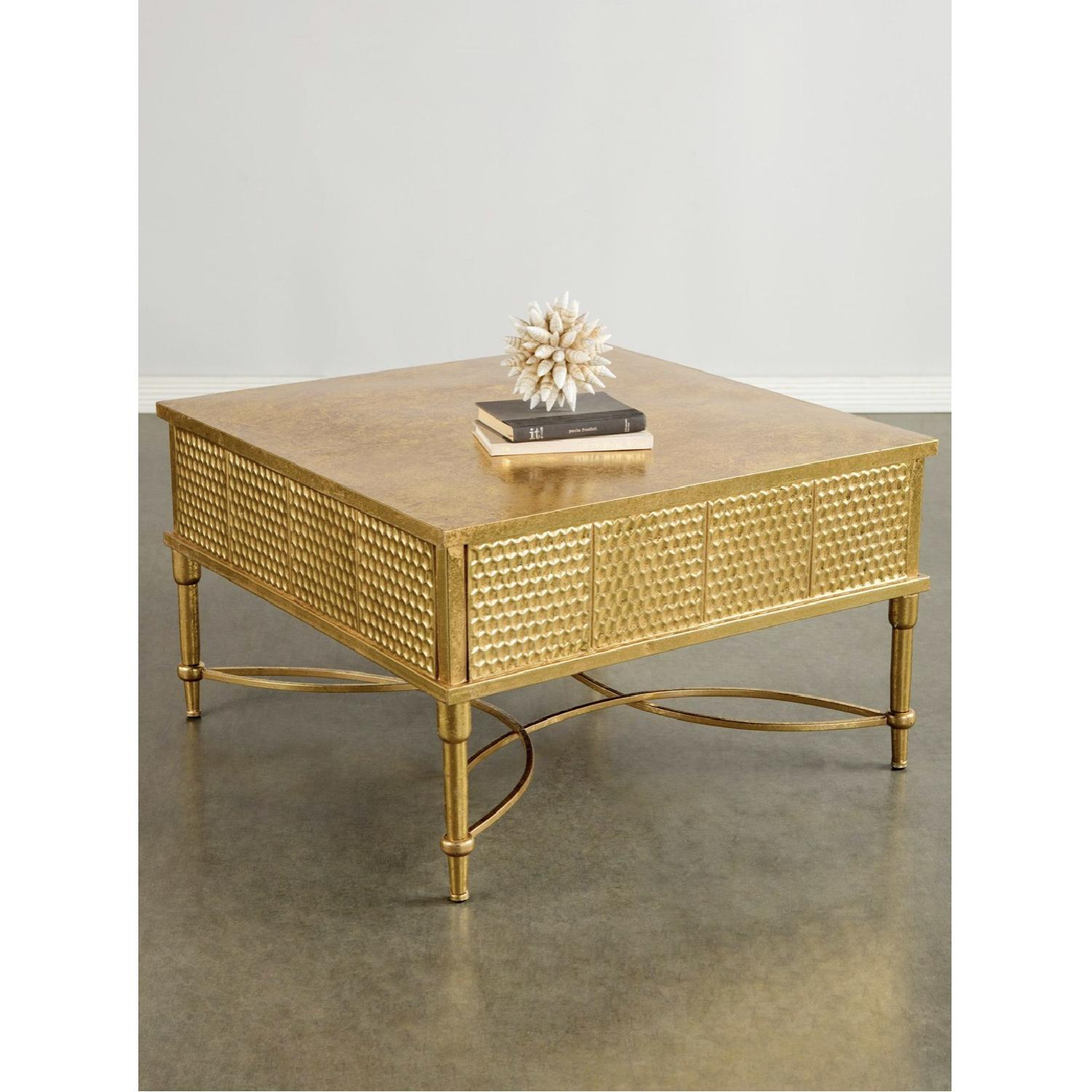 Pictures On Beige Couch With Gold Coffee Table