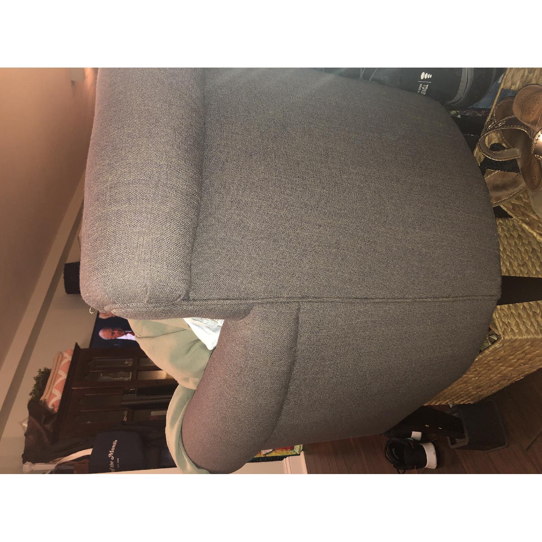 Tufted dark grey armchair