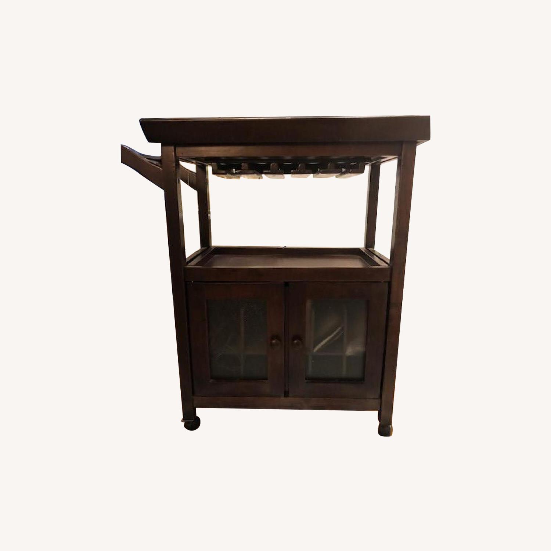 Picture of: Gothic Cabinet Craft Dark Wood Bar Cart On Wheels Aptdeco
