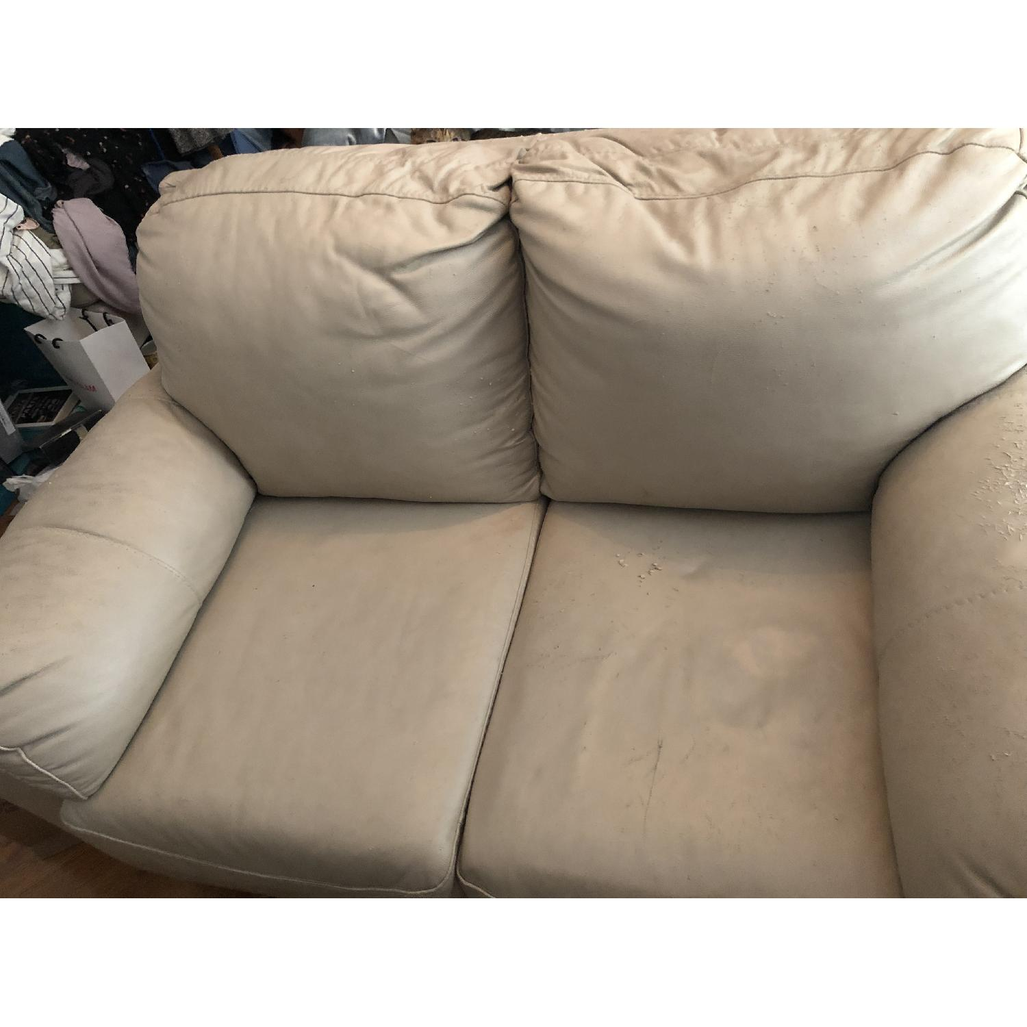 Picture of: Off White Leather Loveseat Aptdeco