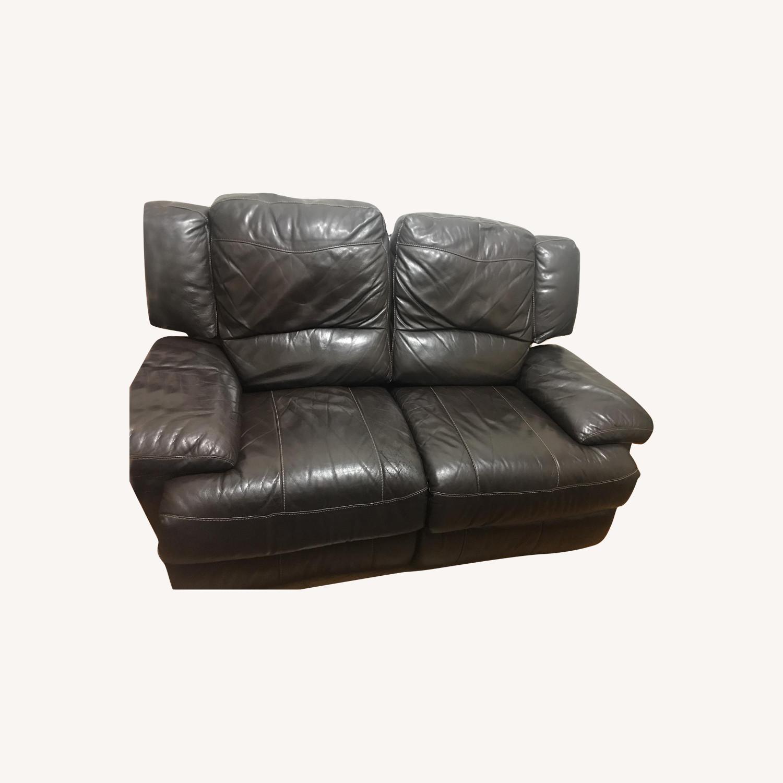 Jordan's Dark Brown Leather Reclining Loveseat - image-0