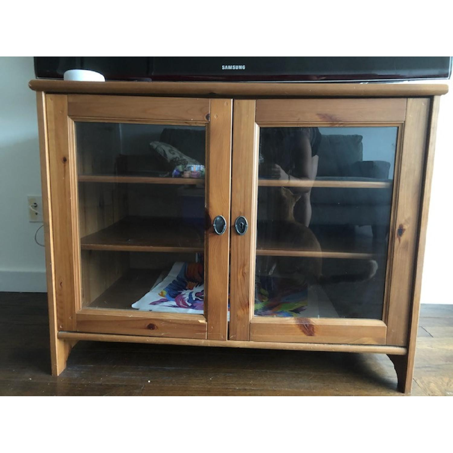 Wood TV Stand w/ Glass Doors - image-1