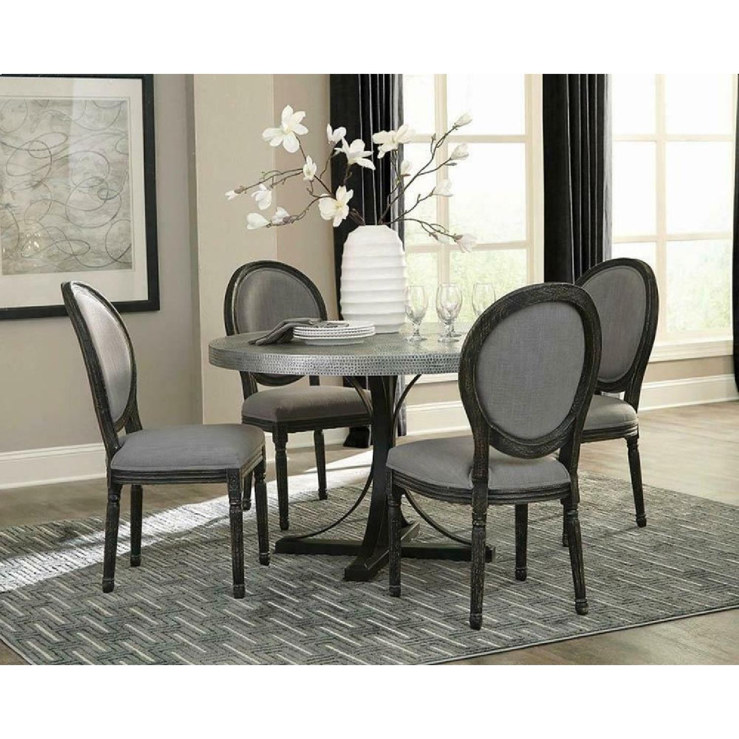 Bohemian Style Round Dining Table w/ Hand-Hammered Iron Top - image-1