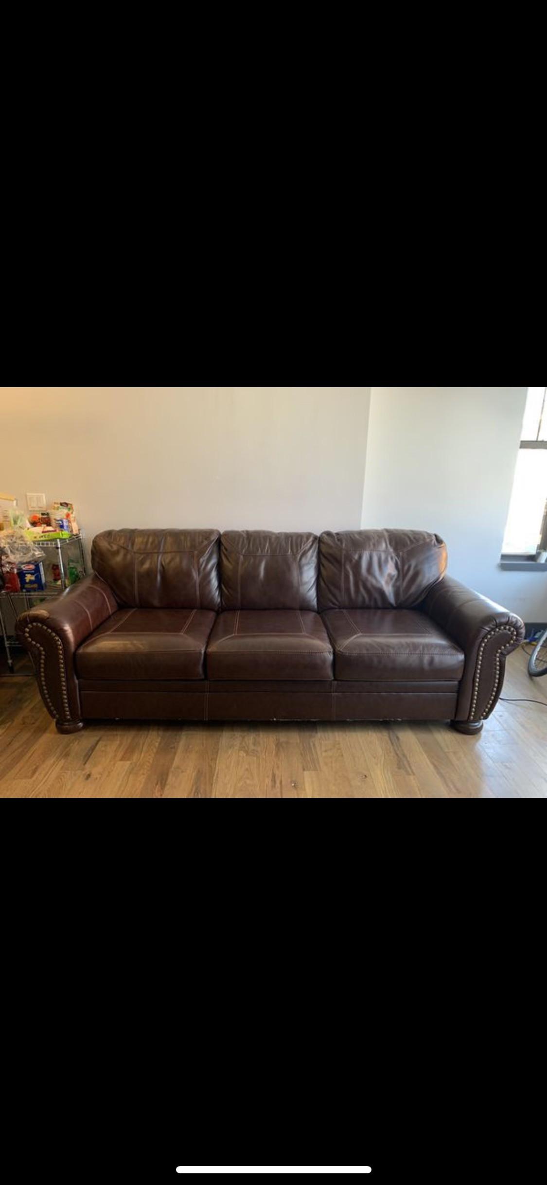 Ashley Brown Leather Sofa w/ Nailhead Trim - AptDeco