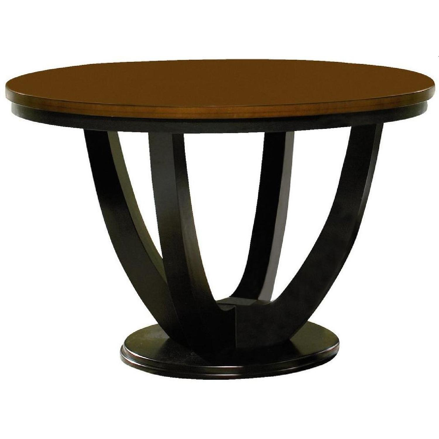 Modern Round Table in Amber w/ Black Base - image-0