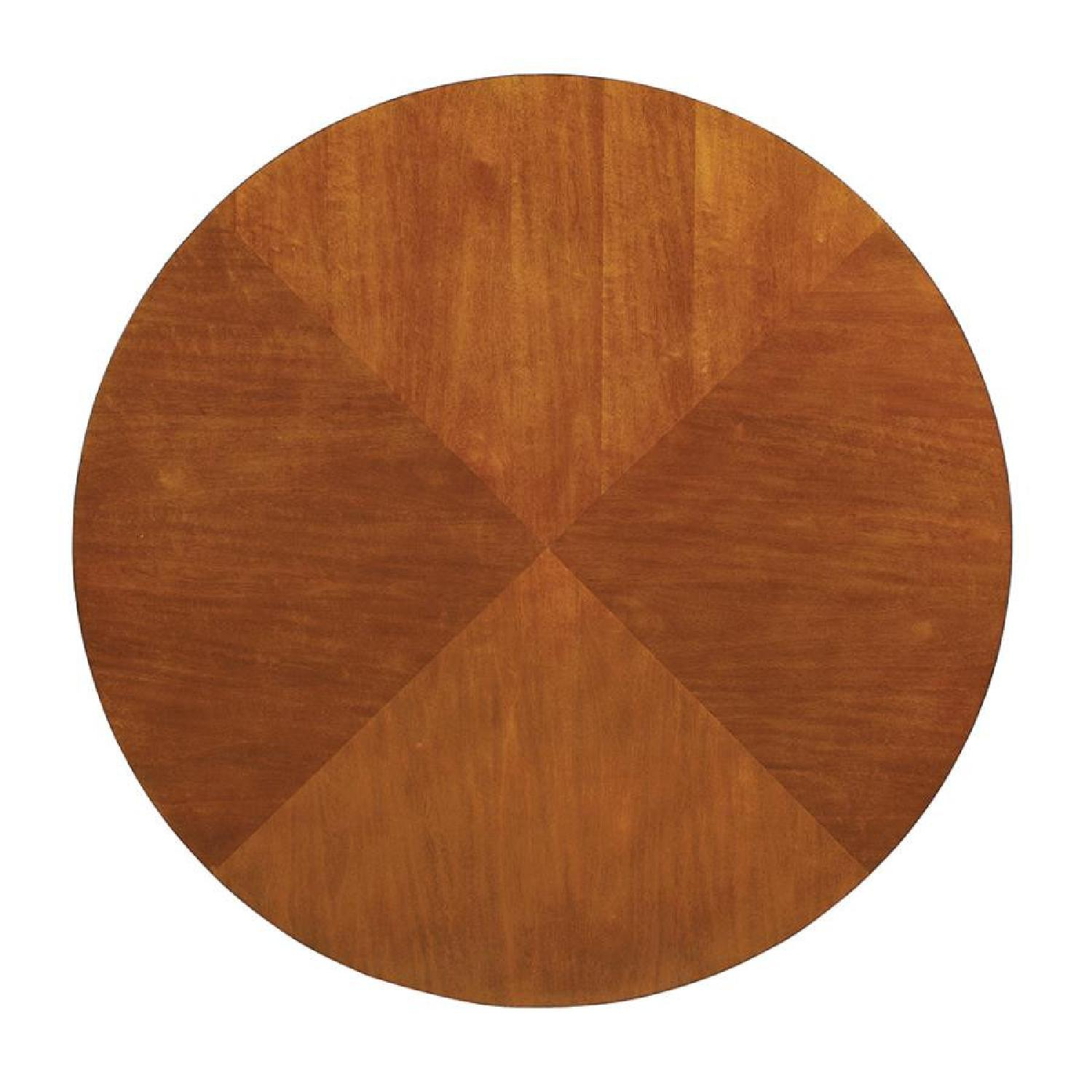 Modern Round Table in Amber w/ Black Base - image-1