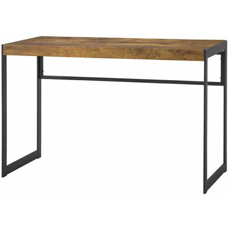 Antique Nutmeg Desk With Gunmetal Legs - image-0