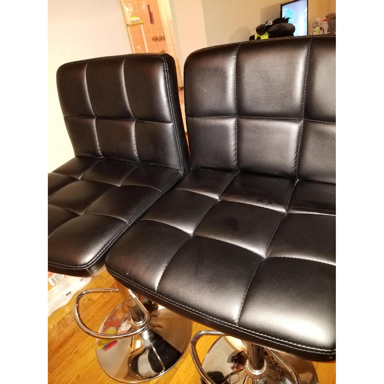 Black Faux Leather Swivel Barstools - image-1