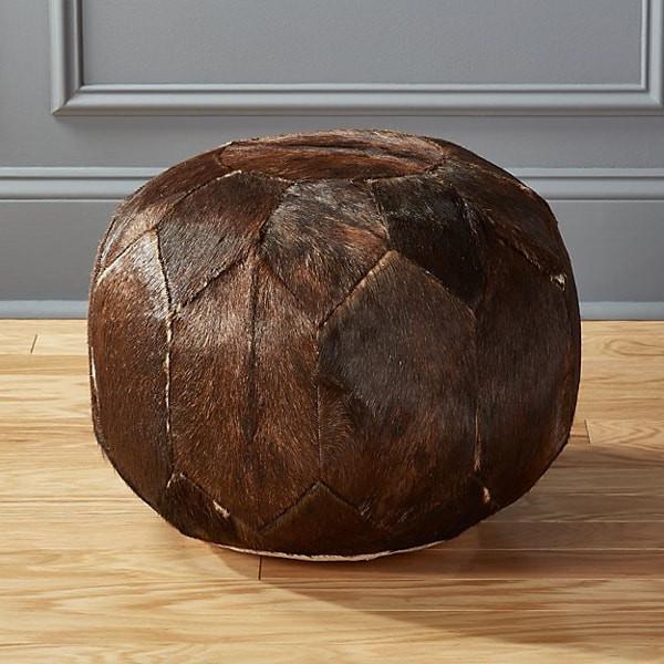 CB2 cowhide Moroccan-style pouf ottoman