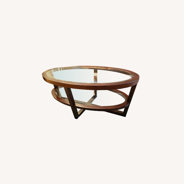 - Raymour & Flanigan Oval Two Tier Glass & Wood Coffee Table - AptDeco