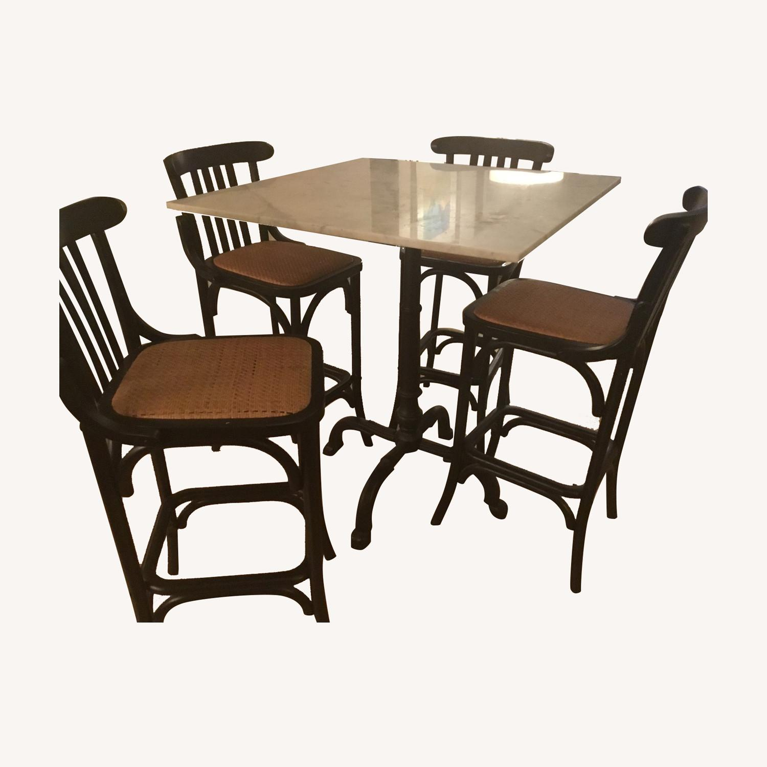 Marble topped table with four matching bar stools - image-0