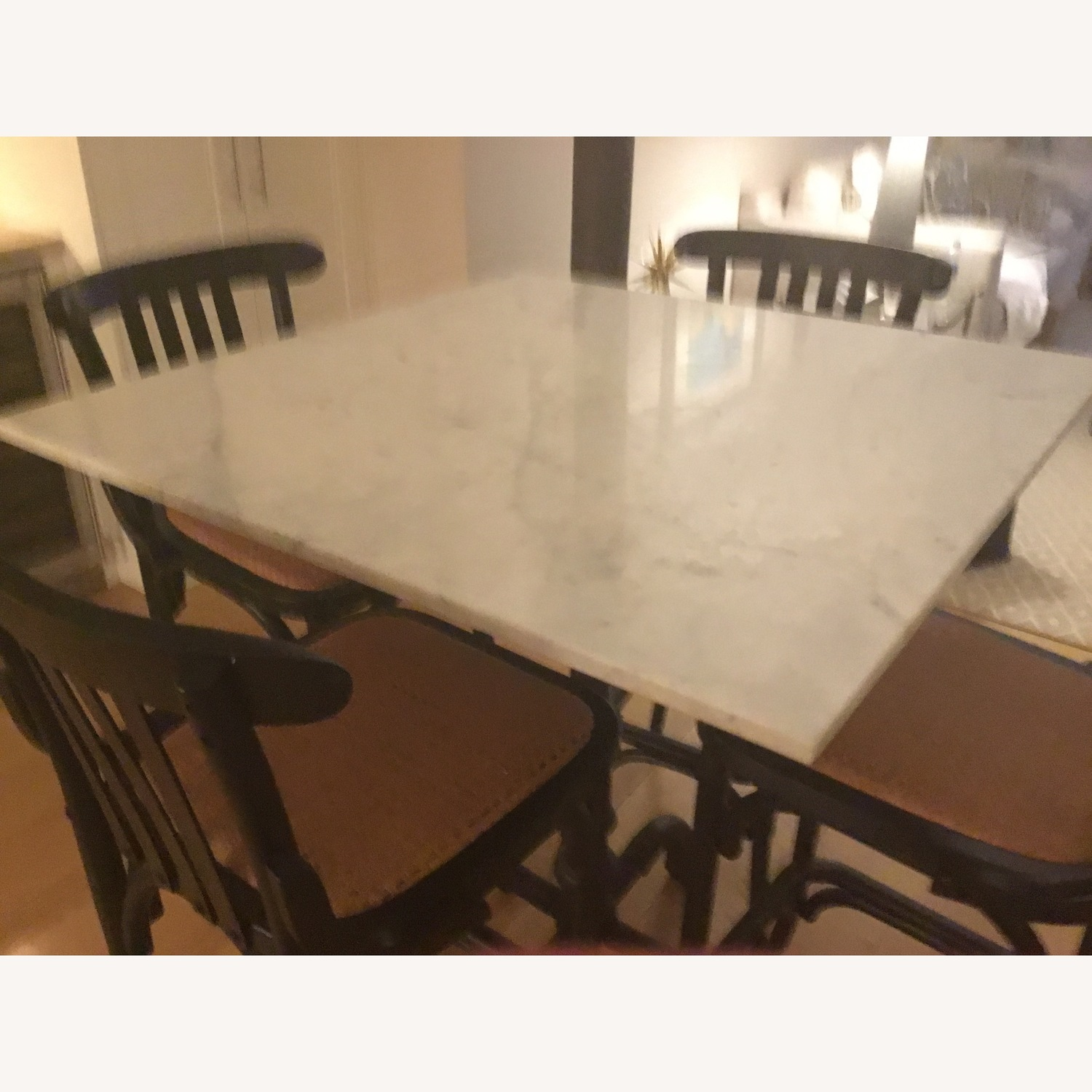 Marble topped table with four matching bar stools