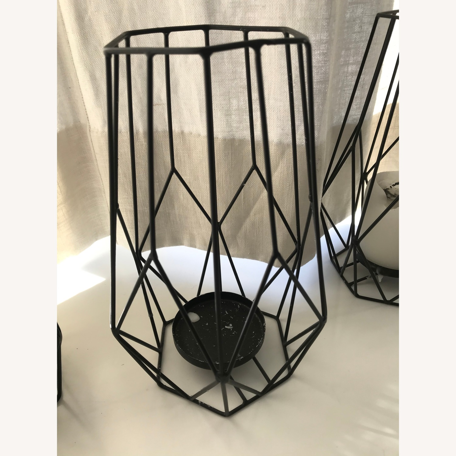 Three black wire candle holders