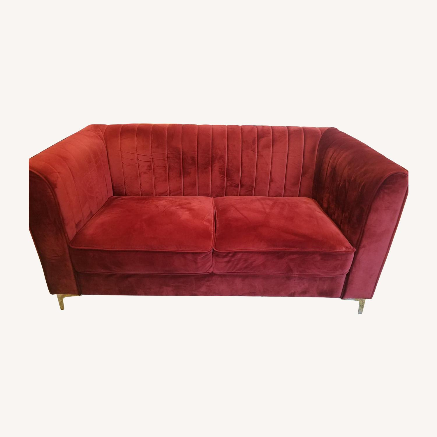 Two-seat red sofa/loveseat - image-0
